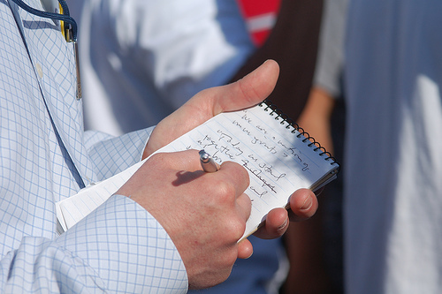 image of reporter writing in notebook